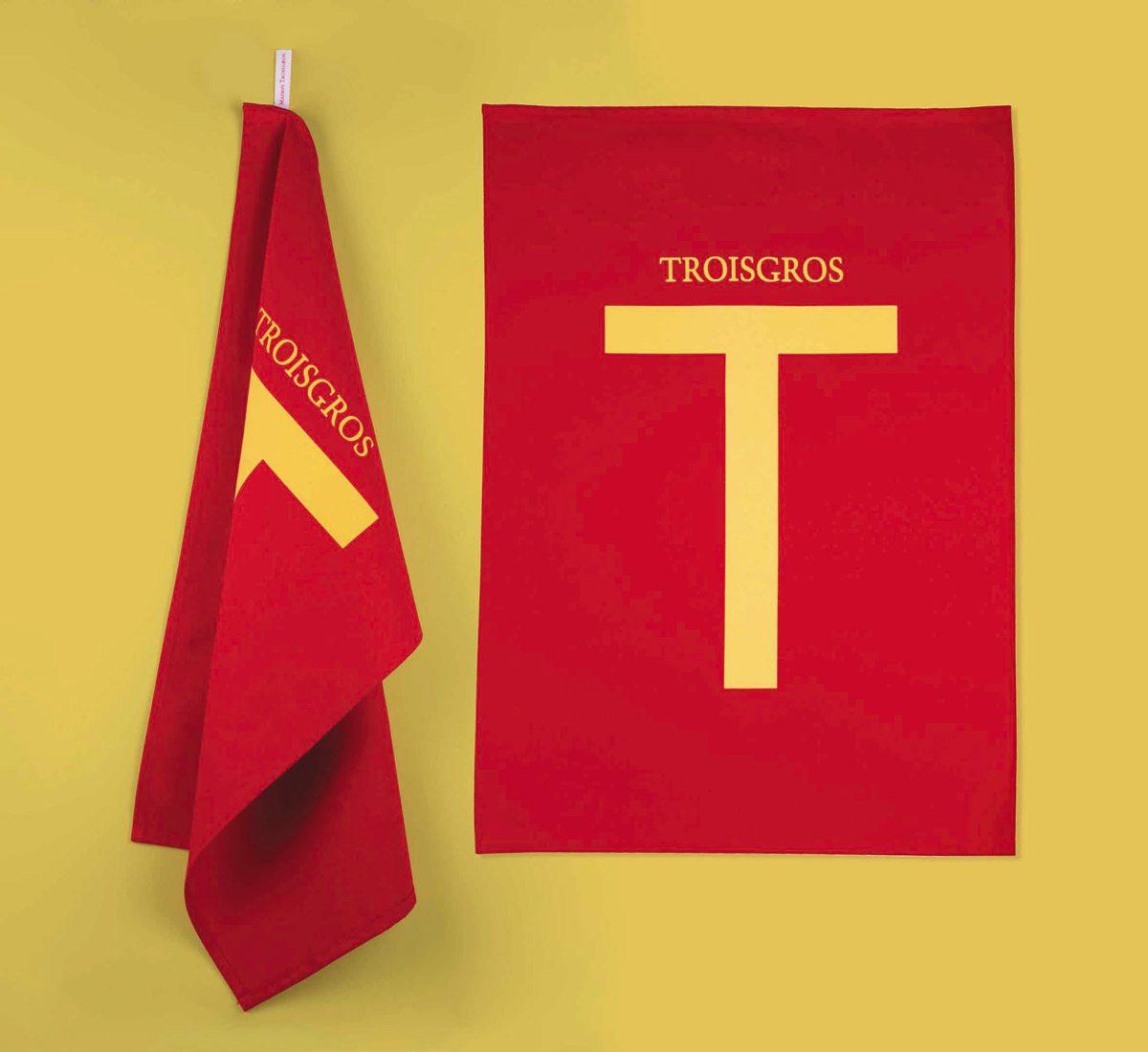 Torchons Troisgros, hôtel et restaurant étoilé, torchons jaune et carmin au design franc et pur, identité visuelle Ich&Kar
