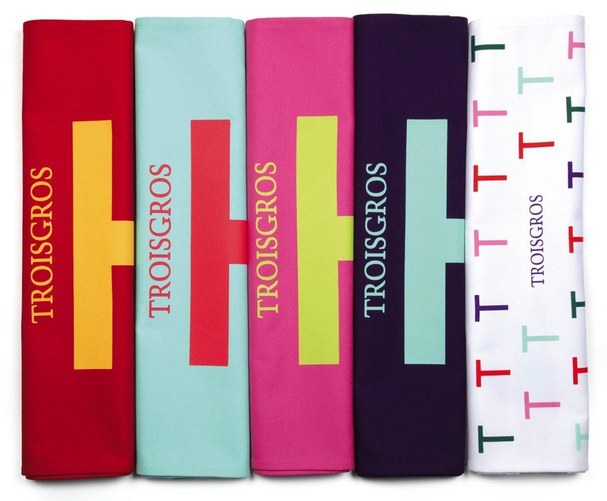 La série de torchon Troisgros, hôtel et restaurant étoilé, design franc et pur au T géant et aux couleurs gourmandes, identité visuelle Ich&Kar