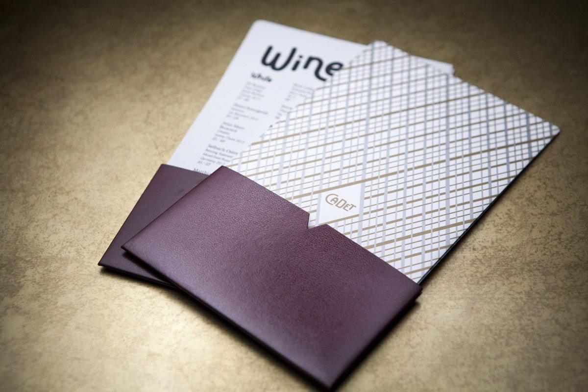Menus du restaurant Cadet de Santa Monica, insérés dans une pochette noire effet cuir. Design ichetkar