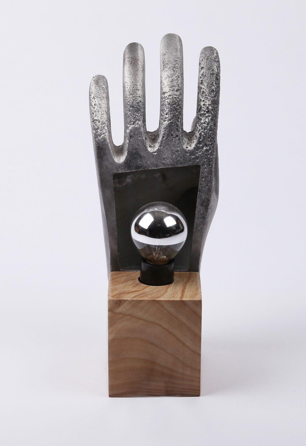 lampe main metal socle bois ampoule au dos ichetkar